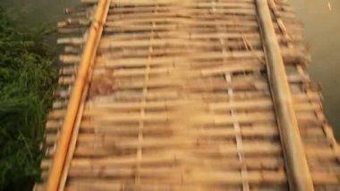 Walking on bamboo bridge — Stock Video