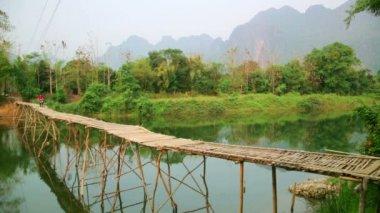 Passing bamboo bridge by motorbike — Stock Video