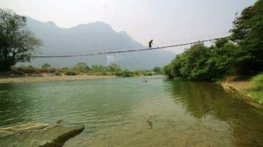 Woman crossing dangerous bridge — Stock Video