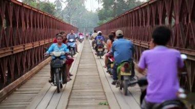 Motorbikes crossing historical bridge — Stock Video