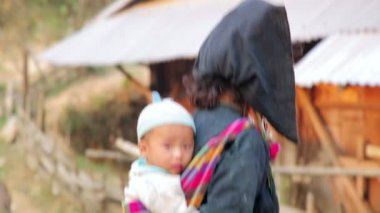 Akha woman carry baby — Stock Video