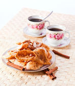 Deep fried pastry with  cinnamon — Stock Photo