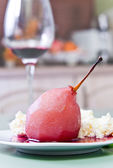 Poached pear with red wine sauce  — Stock Photo