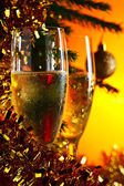 Glasses with champagne and Christmas ornaments  — Stock Photo
