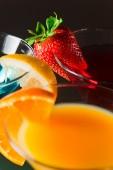 Cocktails  with strawberry, lemon and orange — Stock Photo