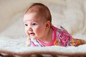 little girl on  beige blanket — Zdjęcie stockowe