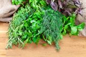 Kitchen herbs on wooden table — Stock Photo