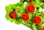 Bowl of mixed salad on white — Stock Photo