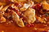 Stewed chicken in tomato sauce — Stock Photo