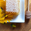 Honeycomb and yellow flowers — Stok fotoğraf #67270717