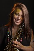 Happy woman with saxophone — Stock Photo