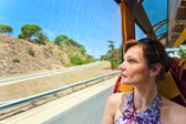 Woman in the bus looks out of the window — Stock Photo