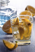 Drink with lemon and ice — Stock Photo