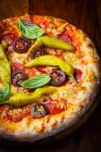 Homemade pizza with dried tomatoes and hot peppers — Foto de Stock