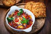 Baked feta cheese with vegetables — Stock Photo
