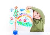 Happy boy presenting his painting — Stock Photo
