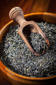 Dry tea in a wooden bowl — Stock Photo