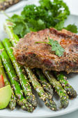 Glazed green asparagus with grilled pork chop — Stock Photo