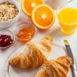 Breakfast with delicious French croissants — Stock Photo #72172677