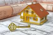 House building with plan and key — Stock Photo