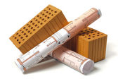 Architectural plans and bricks — Stock Photo