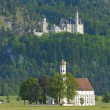 Castle Neuschwanstein and church st. Coloman — Stock Photo #67328443