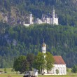 Castle Neuschwanstein and church st. Coloman — Stock Photo #67328569