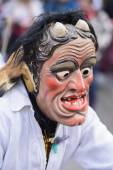 Carnival parade with carved wooden mask designed as scary ghost — Stock Photo