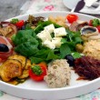 Croatian Meze Lunch, consisting of Local Feta Cheese, Humus,  Tuna Salad, Pickled Mackerel, Parma Ham, Marinated Eggplant and Onion Relish — Stock Photo #52300899