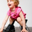 Little girl in big boots — Stock Photo #69803603