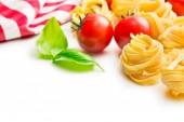Italian pasta tagliatelle, tomatoes and basil leaves — Stock Photo