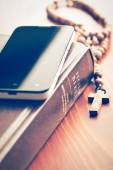 Smartphone with holy bible and rosary — Foto Stock