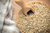 Uncooked buckwheat in wooden bowl — Stock Photo