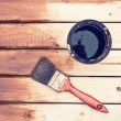 Painting wooden table using paintbrush  — Stock Photo #60438529