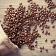 Coffee beans spill out of the sack — Stock Photo #61954693