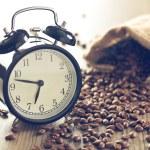 Vintage alarm clock and coffee beans — Stock Photo #61954697