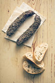 Dried sausage with peppercorn and ciabatta — Stock Photo