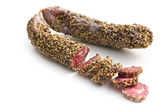 Dried sausage with peppercorn — Stock Photo