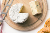 Blue cheese on cutting board — Stock Photo