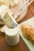 Blue cheese with milk — Stock Photo