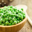 Frozen peas in wooden bowl — Stock Photo #61960261