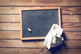Blank blackboard and white chalk — Stock Photo