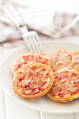 Mini pizza on plate — Stock Photo