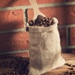 Coffee beans in sack — Stock Photo #65054887