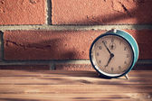Old clock in front of a brick wall — Foto de Stock