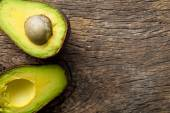 Halved avocado on old table — Stock Photo