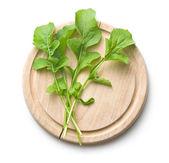 Arugula leaves on cutting board — Stock Photo