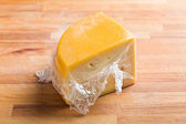 Wrapped edam cheese — Stock Photo