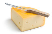 Edam cheese and knife — Stock Photo