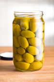 Pickled green olives in jar — Стоковое фото